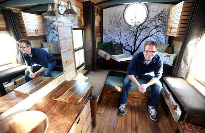 "Glenn Grassi's ""micro-house"" in Erie, Colo., is big on efficiency In a town where 2,400-square-foot houses  with finished basements dominate the marketplace, Glenn Grassi is  betting the other way. Oh, sure, his home has all the basics you'd expect —   toilet, shower, bed, chair, table, stove, sink, even a hardwood floor. But  when all you've got is 84 square feet to work with, certain  efficiencies must come into play. Grassi's bed doubles as a shower, his  chair doubles as a commode, and his wood-burning stove doubles as a  furnace and cooking surface. Read the rest of the story This story is originally from the Boulder Daily Camera, who also have a Tumblr (but didn't post it there!)."