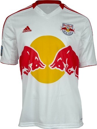 "The new @NewYorkRedbulls kit by @AdidasSoccer was unveiled today. SADLY, it's NOT  SICK. While fans hoped the New York Red Bulls would end the tradition of a MASSIVE  RED BULL LOGO emblazed on the chest, it appears they've made it EVEN  BIGGER for 2012. We appreciate the clean lines of the design and definitely think  they were headed in the right direction. It just seems like someone said, ""Can  we make the logo bigger…"" We'll drink Red Bull, we'll call them the Red Bulls - we just wish they could cut fans some slack on the kit. All we can hope for now is that the club  will recognize the fans' wishes and create a third kit that answers the  call."