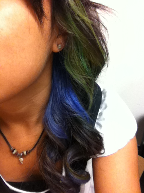 evelynnmartinez:  My hair today. I curled it and since I have a white streak next to the blue hair my sister colored it with a green highlighter, I must say it look pretty cool!