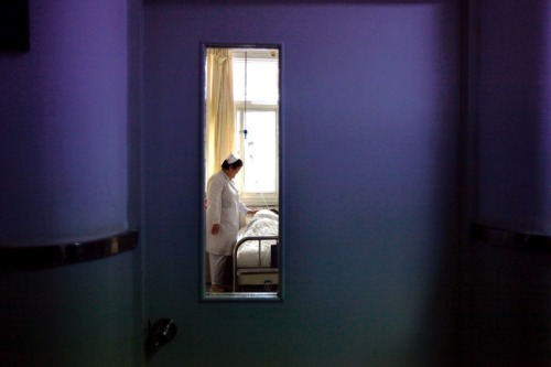 Beijing, China: A patient in the HIV/AIDS ward of Beijing YouAn Hospital. (Dec 1, 2011) David Gray / Reuters More Photos of the Day.