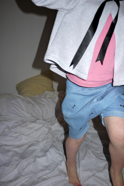 Annabel is wearing shorts: handmade/ printed by Oh My Kids vest: handmade by Oh My Kids