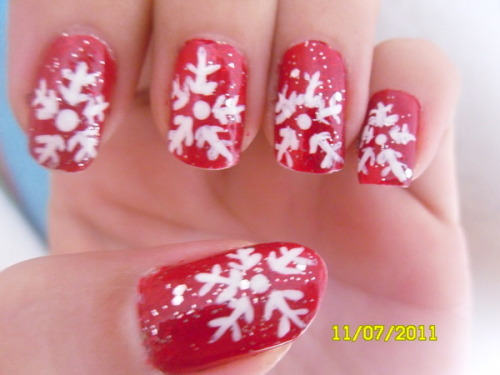 Get in the festive spirit with some red snowflake nails like Beautylish Beauty Amanda H.'s!