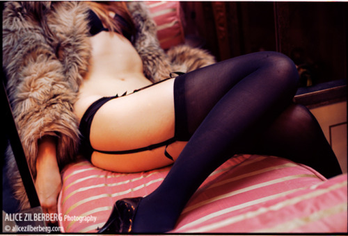 forthespankbank:  Fur coat, stockings, garter belt.