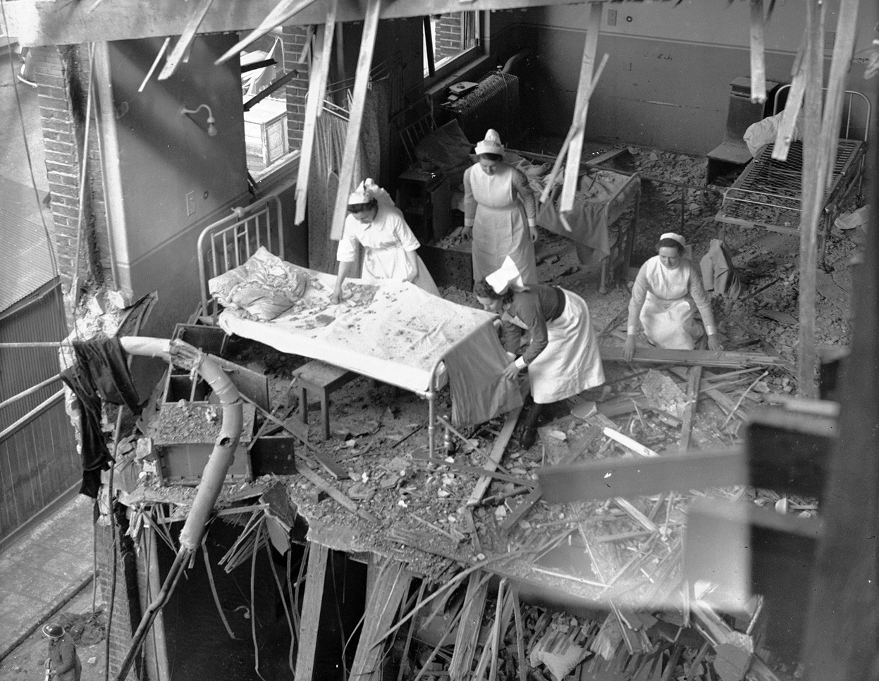 Nurses clearing debris from one of the wards in St. Peter's Hospital, Stepney, East London, on April 19, 1941 after a German bombing raid   So freaking cool