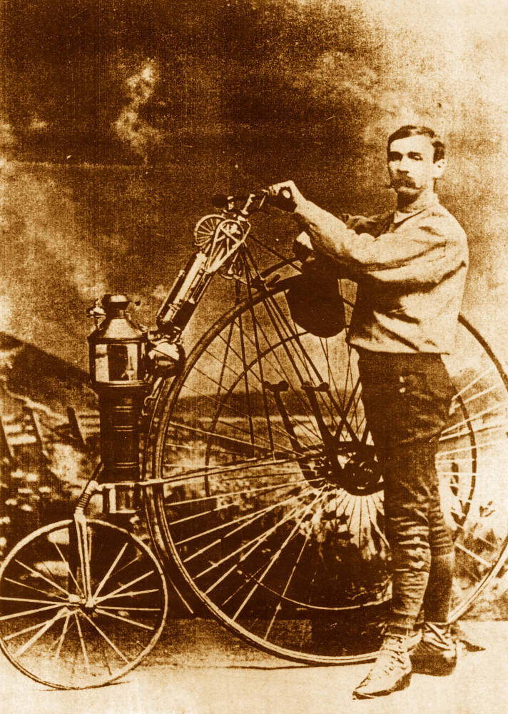 "afrormosia:  ""Photograph of Lucius D. Copeland standing beside motorized bicycle that he invented in Phoenix (Ariz.)"" (It looks like he's mounted a very lightweight boiler and steam engine on an American Star bicycle. Shades of steampunk?) (Arizona State Library, Archives and Public Records. History and Archives Division, 02-0133.jpg.)"