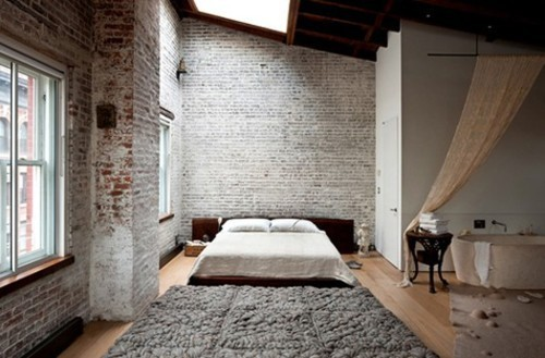 Brick walls in a loft space with a skylight = ultra sexy bedroom…