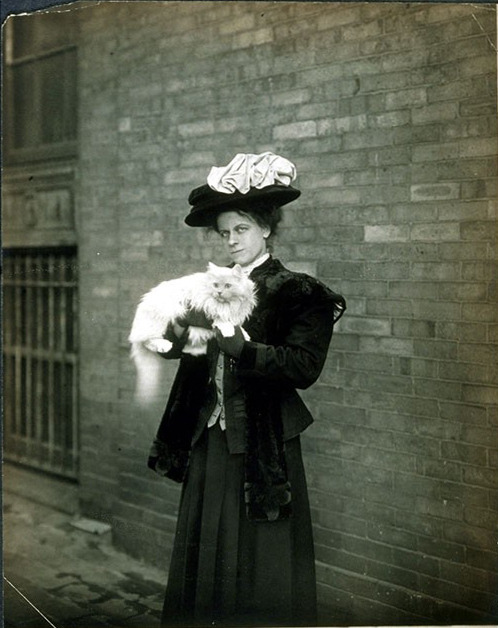 petsincollections:  Unidentified woman standing outside with her cat in her arms. A brick wall is behind her, ca. 1905-1910. Photo by Jessie Tarbox Beals. Is part of Jessie Tarbox Beals Photograph. Schlesinger Library, Radcliffe Institute, Harvard University.
