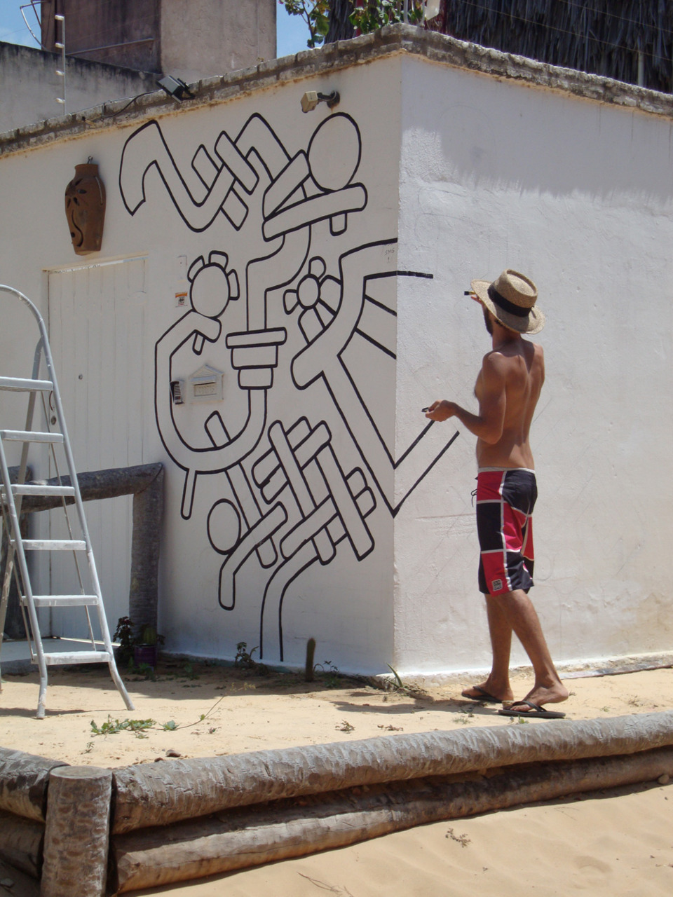 Mural in progress in Jericoacoara. If you're in town, stop by Labirinto Residence.