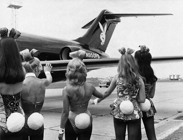 Playboy Bunnies wave as Hugh Hefner's private jet lands in London - 1970.