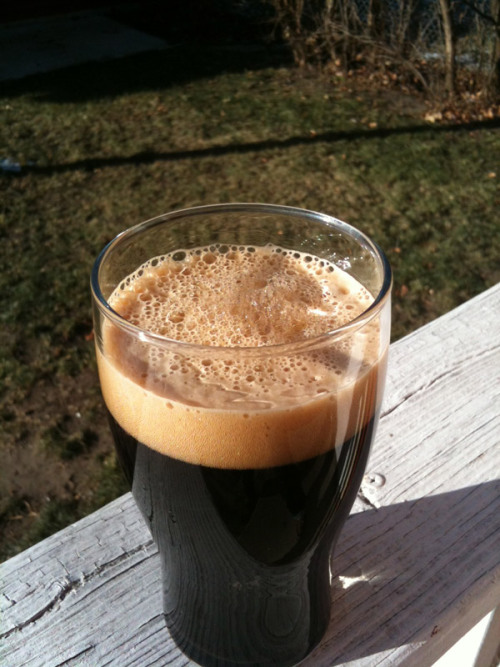 Smoked Porter, 6.9% abv Mmm, smokey. One month in primary, one month in secondary, and a week and a half of bottle conditioning fared well for this winter time beer. Pours pitch black with a creamy, tan head. Mouthfeel isn't overly heavy or thick, which is preferable. The flavor, besides being smokey, is rich and malty with notes of coffee coming through. The hops definitely take a back seat with this beer. Really smooth and easy to drink. This will make for a fine wintertime nightcap… Cheers!