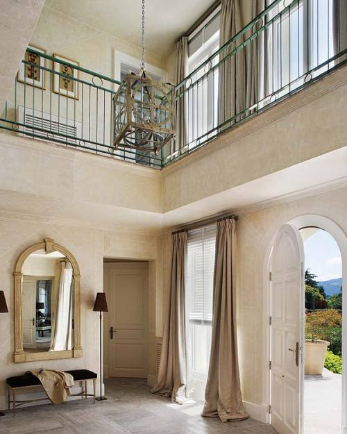 A beautiful and inviting two-story Mediterranean style foyer (via delight by design: {calming} first impression)