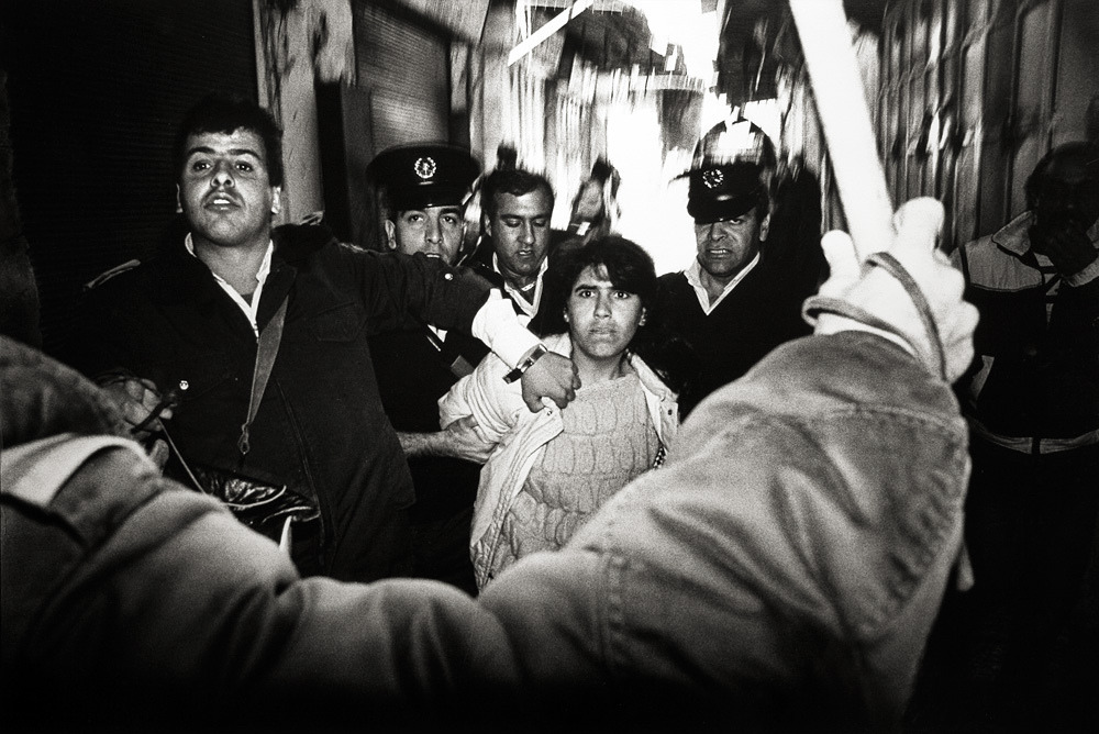 Arrest of a young Palestinian demonstrator. The Old City, Jerusalem. 1988.