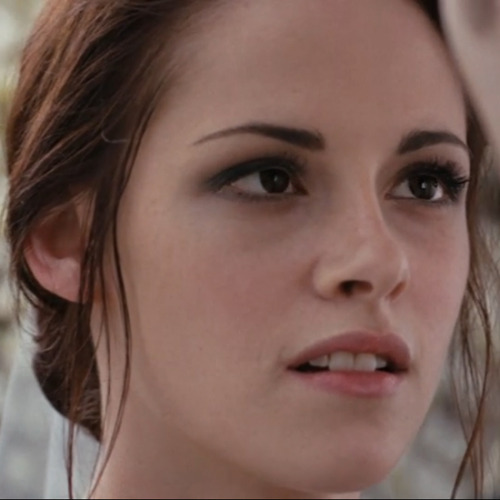 Bella Swan wedding makeup look Here are some tips from makeup artist Stacey Panepinto who was Kristen Stewarts makeup artist in Breaking Dawn Part 1. Foundation primer: Use a makeup primer on the face to hold the makeup for long hours. Foundation: Use a foundation combined with a brightening lotion so the skin would have a glow. Prep the eyelid with eye shadow primer. The key to keeping eye shadow from creasing as the day goes on is to keep the lids oil-free. Eyes: Sweep a light, shimmery shadow over the eyelids to your brow bone. Then apply a dark eyeliner to the top lid. Next, blend in a darker shadow color starting at your lash line, blending up. Make sure to blend the dark color into the lash line so the eye liner disappears. Stop deep color at crease. For the bottom of the eye, use a soft pencil or the shadows and draw the line and then smudge it. Finish with a couple of coats of black mascara on both sets of lashes. Blush: Use a sheer pink blush on the apples of her cheeks for a hint of color. Gloss: Apply a pink-toned lip gloss to finish the look. Source:  www.bellasugar.com Here are products you can use to Create This Look For Less. FACEL'Oreal Studio Secrets Professional Secret No.1 Magic Perfecting Base $13Victoria's Secret Pro Radiant FX face illuminator $15 (Mix this with your moisturizer)Dream Mousse Blush in Pink Frosting $7 EYES Urban Decay Primer Potion $10Maybelline Eyeshadow Single Champagne Fizz $5 (apply on your eyelid up to brow bone)Revlon Luxurious Color Eyeliner Black Velvet $10 (apply on top lash line)Maybelline Eye Studio Color Pearls Marbleized Eyeshadow Carbon Frost $7 (blend the darker gray starting at lash line and blend up.  Stop deep color at crease.  Use same dark shadow to line bottom lash line and smudge it)Cover Girl Lash Blast Fusion Mascara Very Black $10 (apply to top and bottom lashes)  LIPSNeutrogena Moisture Shine Lip Gloss Fruity Pink $9 Total:  $86