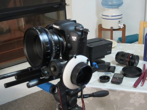 Working with Carl Zeiss glass, Canon 7D, and a RedRock micro rig. The new CP line by Carl Zeiss is simply amazing. Since the lenses are all prime you get tac sharp images with a metal un-clicked housing. pulling focus or changing the aperture is a breeze on these things. Only problem I see with these things is their price. Each lens costs as much as the camera and if you are using a 7D to film with are you really the type to be in the market for a 3k cinema lens? The one thing I have to say is that the canon 7D is a complete waste of money in my opinion. It has the exact same specs as the 60D including the same sensor. So why so much? You pay for the alloy body and rugged casing. But then again if you are a professional photographer that needs that type of quality build then you should be working with a 5D or 1D either way. even as a secondary camera the 60D would work just as well. For film work the 7D was average and best. In all honesty im thinking of going with a 60D next time we have a film to shoot. Now, i say this about the Mark II. I am holding out for the Mark III, because if they can fix the moire problems, the rolling shutter problem and give the 7D higher dynamic range it can def compete toe to toe with bigger more expensive cameras! Fingers crossed!