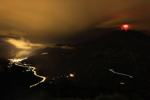 Cotalo, Ecuador: The erupting Tungurahua volcano and the city of Banos at night Photograph: Jose Jacome/EPA (via 24 hours in pictures | News | guardian.co.uk)