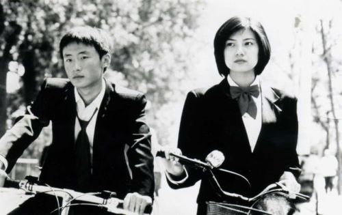 Li Bin and Gao Yuanyuahn ride bikes.