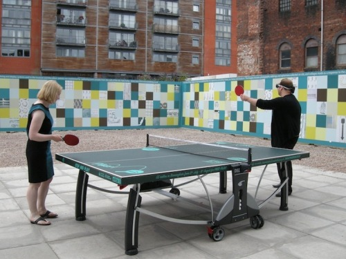 Artist Nikki Pugh encourages workers to play table tennis wearing sonar blindfolds.