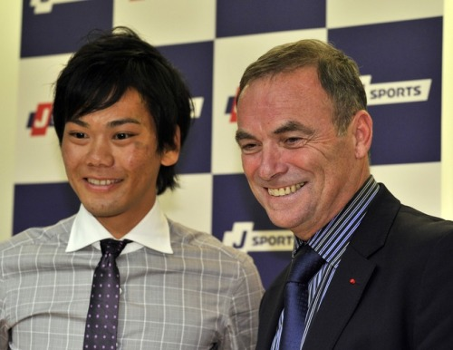 French cycling legend Bernard Hinault poses with Japanese road racer Yukiya Arashiro, who participated in the Tour de France 2010, in Tokyo on December 2, 2011 as he presents course layout of Tour de France 2012. AFP PHOTO / Yoshikazu TSUNO (via French Cycling Legend Bernard Hinault Poses - Yahoo! Sports Photos)