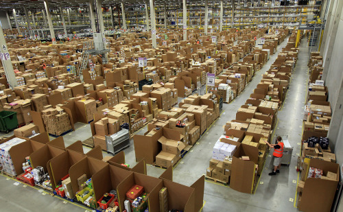 Amazon's largest distribution center in the world gears up for Christmas  Staff at the Amazon Swansea fulfillment center process orders as they prepare their busiest time of the year, on November 24, 2011, in Swansea, Wales. The 800,000 sq ft fulfillment center is one the largest of Amazon's six in the UK and the also the world. (Matt Cardy/Getty Images) (via It's Beginning to Look a Lot Like Christmas - Alan Taylor - In Focus - The Atlantic)