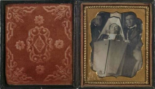 ca. 1850, [post mortem daguerreotype of a clergyman in his casket] via the International Center of Photography