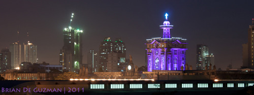 byrone02:  UST Main Building Tower + Manila Skyline at night as seen from Eng'g-ICS (5th floor) area :D