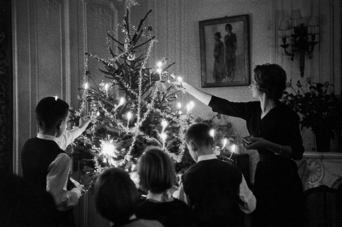 historiful:  Lighting the Christmas tree - an unknown woman and her children. Photographed by Janice Niépce, date unknown.