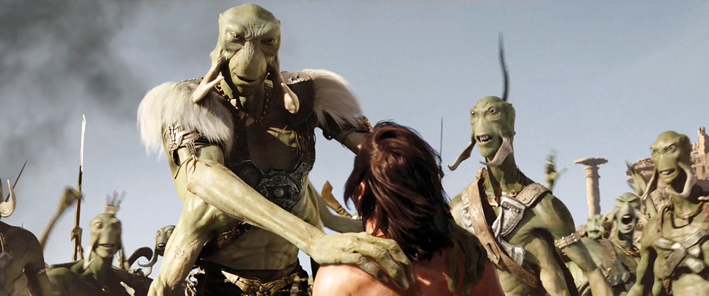 Willem Dafoe as martian Tars Tarkas speaks to Taylor Kitsch as John Carter in Andrew Stanton's John Carter of Mars, hitting theaters in March.