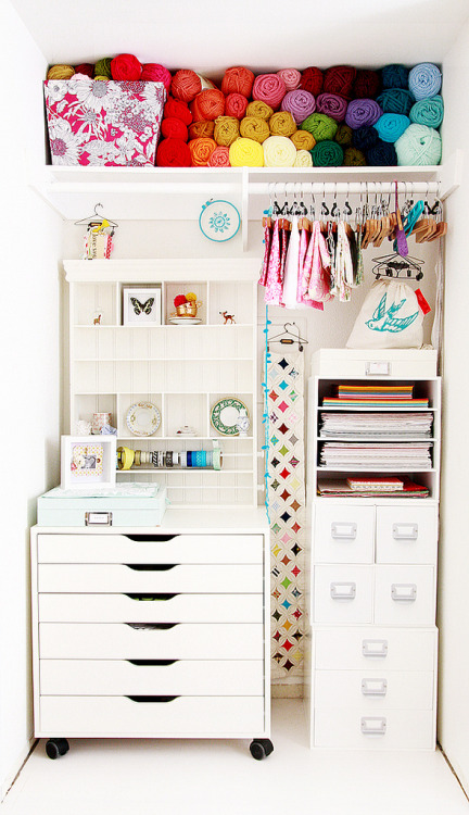 This is a gorgeous craft closet. I only wish that was all the fabric I had to store. (Not really, but I wouldn't be able to fit even one of my bins.)  I wonder, does this mean I need to pare down my fabric stash?
