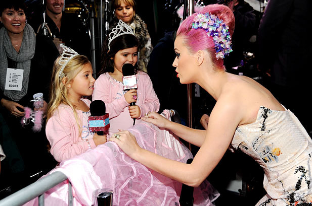 SOooooo CUTE: Katy Perry and Sophia Grace Brownlee and Rosie Brownlee at the 2011 American Music Awards at the Nokia Theatre in Los Angeles on November 20th, 2011.