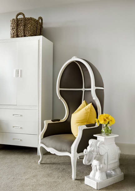 An elegant and modern interior with classic touches: a Louis XV canopy chair in white with deep gray upholstery, and an elephant plant stand used as a side table. (via The Decorista-Domestic Bliss: my love affair with elephants…)