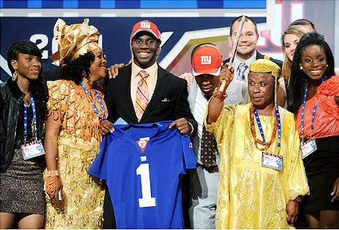 "Prince Amukamara when he got drafted in the NFL . #TeamNaija   You know you're African when your parents automatically root for his team to win just because he's African  Look at his father! He's like, ""Oya! begin to bow."""