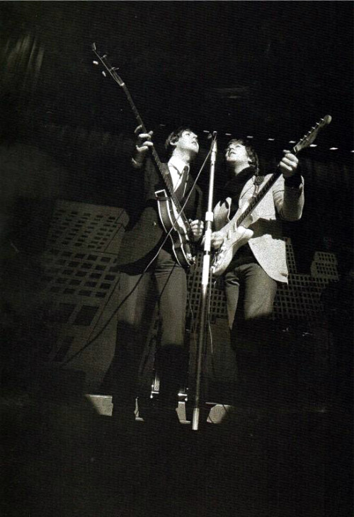 Always liked this mysterious photo of Lennon playing his Strat onstage.