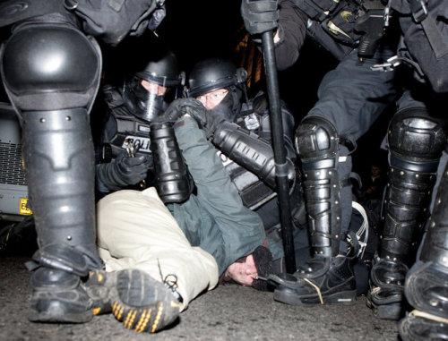 "timfsbrown:  Portland, Oregon — December 3, 2011 — Portland police arrest a man during the Occupy Portland protest in Shemanski Park. Photo by Ray Whitehouse/The Oregonian (via Occupy Portland attempts to occupy another downtown park | OregonLive.com)  I just watched ""Brazil"" (1985) and the police in this image look strikingly like the ones in the film. Gotta love dystopian reality."