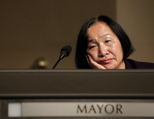 Who's Who of the Occupy Movement: Jean Quan, mayor of Oakland, California On Oct. 25, Mayor Quan authorized more than 500 police officers to use tear gas, rubber bullets and batons to evict the Occupy Oakland camp. Hundreds of demonstrators were injured, including veteran Scott Olsen, who was hospitalized with fractures to his skull.  These authorizations came to force her legal advisor Dan Siegel, and Deputy Mayor Sharon Cornu, to resign. Later that day, nearly 1,000 marched in solidarity with the protesters who had been victims of police brutality and who had been evicted from the camp. The livestream of all these events were witnessed by more than 60,000 viewers.  Quan made the news again when she admitted during a BBC interview that a network of 18 city mayors coordinated to evict occupations across the country. A petition to recall Quan's position is currently in its third draft to qualify the measure for a November 2012 ballot vote.  -G.Razo