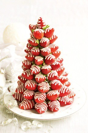 Strawberry Christmas Tree...simple to make!  Buy the freshest strawberries you can find. Dry them well and bring them to room temperature so there's no condensation on them Pointy strawberries give your tree the best appearance. Use a bag and tip to drizzle white chocolate (white & green) over strawberries. If the chocolate in the bag goes hard between layering, simply re-melt in the microwave for 20-30 seconds.  Use a styroform cone as your base and frost with green white chocolate. Use toothpicks to adhere strawberries to the cone. To reduce the toothpick size, stick the pointed end into the cone to make a hole. Remove and cut off one-third. Place the blunt end back into the hole in the cone and skewer the strawberry with the sharp end. Fill between berries where needed with green white chocolate. Ta da! Done :) via Taste.com.au