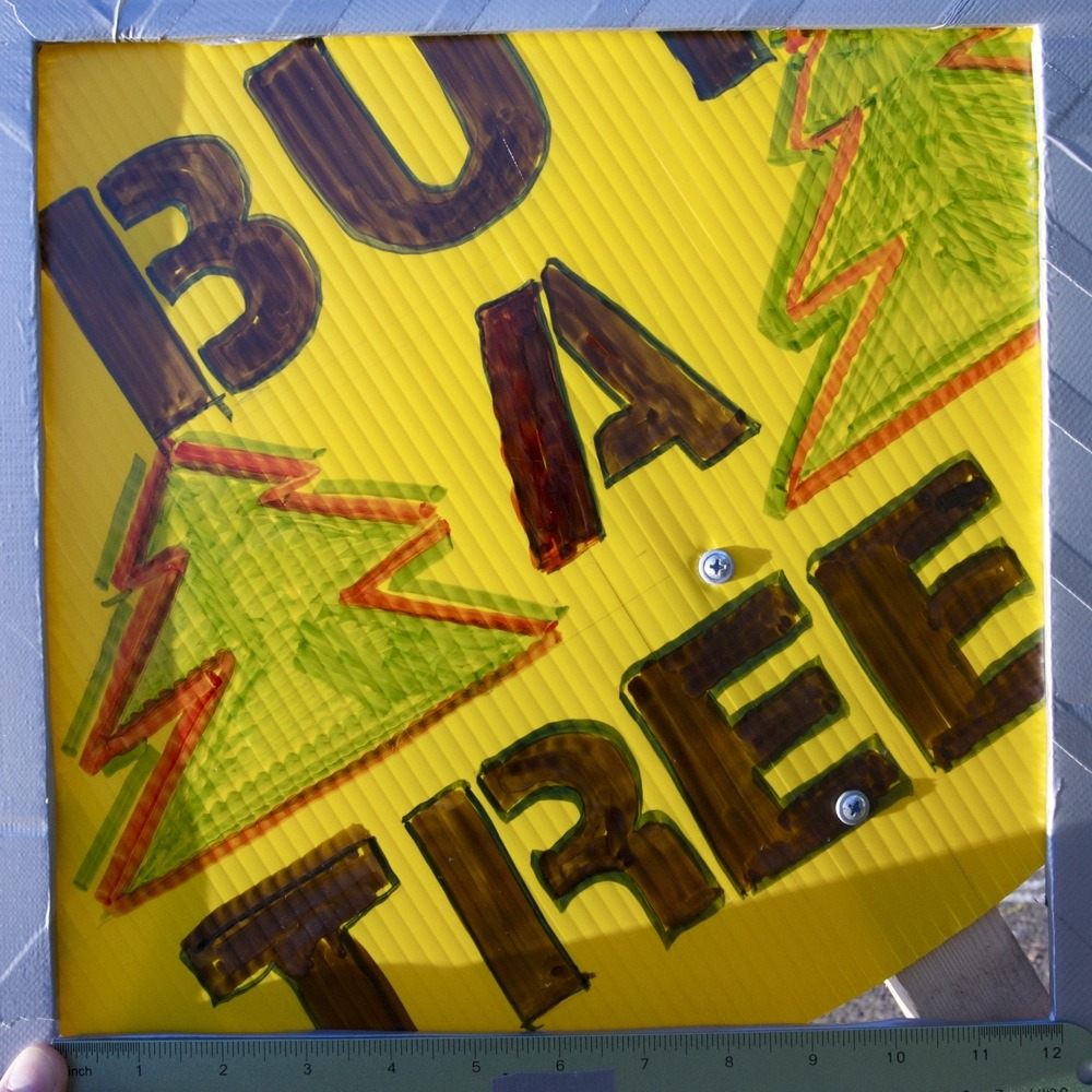 "Sign for Christmas tree lot, ""SET GIRLS FREE - BUY A TREE"", N Lombard St. I only caught a could of stitches of conversation between a tree shopper and one of the folks working the lot; the latter sounded like he was explaining the situation to the former, definitely used the phrase ""sex trafficking""."
