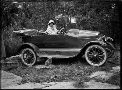Woman with her new Maxwell car and dog, Shoalhaven, ca. 1920 / photographer Cyrus S. Moss by State Library of New South Wales collection on Flickr.