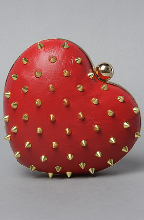 Mata Hari x Melody Ehsani Heart Clutch. I was looking through the new bags on www.karmaloop.com and this IMMEDIATELY caught my eye. If the striking red color isn't bad ass enough for you I'm pretty sure the striking gold studs will feed your inner rebel! This bag also come in Black and Nude(which is more of a bone color), each color is just as rockin as the red. This clutch is priced at $63 but using rep code MISSAMAZING brings the price to $50.40 Happy Shopping loves :)