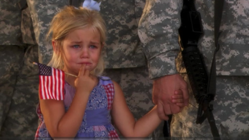 od-a:  Story behind this? Her dad was leaving on a 2 year deployment. She was crying, and wouldn't let go of her dad's hand, even when he stood in line, saluting. No one had the heart to break them apart.