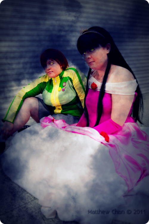 "Shadow Chie and Shadow Yukiko The Shadow Chie is moi, the Yukiko is my good friend, taken at the London MCM Expo in October (feels like forever ago now) The photo was taken by the awesome photographer Matthew ""Blasteh"" Chan! I edited it in photoshop and picnik to alter the yellow eyes, add the creepy smoke, general alterations blahblahblah NOW HAVE FUN AS OUR EYES PEIRCE INTO YOUR SOUL HAHAHA"