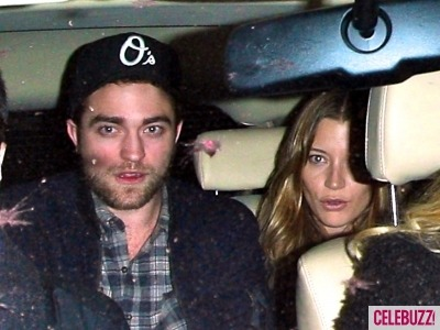 celebuzz:  We spy with our little eye Robert Pattinson with a girl that isn't Kristen Stewart!  Uh ooh haha