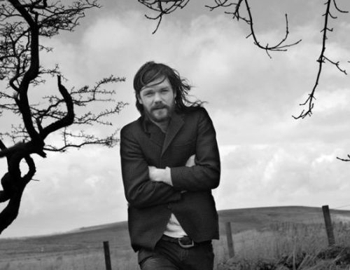 INTERVIEW: RODDY WOOMBLE Roddy Woomble has got it right. He's fulfilled the rock star dream fronting Idlewild; scratched the writing itch with several contributions to newspapers and magazines; achieved critical kudos with his captivating solo folk music; and dabbled in radio presenting, painting and (once upon a time) photography. Now nestled away in the western isles with his family (chickens and all), Roddy's appearances on the music scene are rare compared to his Idlewild days, but when he ventures out you can count on a special show. This winter, the Tolbooth will play host to Roddy's Christmas Hootenanny – an evening of high-spirited festive entertainment from Roddy, his band, and hand-picked supports.  You are curating a special Christmas evening at the Tolbooth on 16th December – what do you have in store for guests?We'll be doing a full band set and a few Christmas songs. Seonaid Aitken is opening up with her band which will be great, and also Foxface, so it's a good bill for sure. There'll be a session going on in the bar too (musical rather than drinking – perhaps both). For those who haven't heard of your support acts, what can they expect?Seonaid's band are along the trad folk route and Foxface are a bit more left-field, country-ish. Both are well worth listening to.  Are you a fan of Christmas time? How will you be celebrating this year?I love Christmas and will celebrate it as I do every year, with my family, a large meal and a decorated tree.  You live in the western isles and own chickens, which reminds me of Alex James from Blur retiring for a quiet life. Has it been a dream to settle down after years of mad touring? I'm not a rich man like Alex James so can't retire, but I'm happy living where I do and I prefer the space and quiet and trying to rely less on shops and suppliers. But I also like visiting cities, eating in restaurants and playing gigs, so I'm not a hermit. Not yet, anyway. You have ventured into journalism – any plans to write something more substantial, like a novel or autobiography?I'd like to write more, maybe a book, non-fiction. Who knows when. Having experience of both a very successful band and a well-respected solo career, where do you sit on the commercial success Vs artist respectability line?Who wouldn't want to be popular critically and commercially? Unfortunately that happens to very few people. It's either one or the other. The general public don't really care what critics say – they care about what they hear on the radio and TV. It's the music fans who read the critics, and they're a picky and fickle bunch! I've come off lightly thankfully, but a few more nice reviews and record sales wouldn't hurt.  We interviewed Rod Jones recently, whose new band The Birthday Suit goes down the rock route and has been hailed by some critics as similar to early Idlewild material. He said he is still influenced by you. Have you listened to his new record, and what do you think?I have and I like it. Rod's a fantastic guitar player and melodist and really pays attention to detail. I'm a lot more ramshackle in my approach. I suppose that's why we worked well together. What do you think of Stirling? Any favourite haunts?I like it, although I haven't spent much time there. I like the Tolbooth the best of course. Roddy Woomble's Christmas Hootenanny takes place on Friday 16th December at 8pm. Call 01786 27 4000 for more information. Interview by Hannah Currie