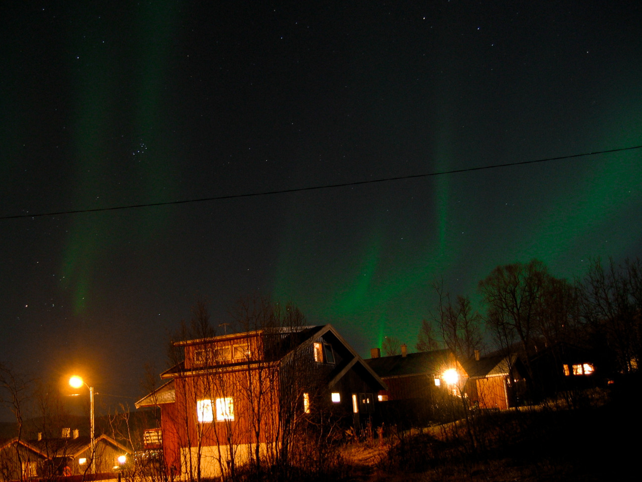 Tromsø, Norway 2004. First attempt of photographing the Northern Lights, taken on colour slide. Haven't had nearly enough opportunities to improve my efforts.