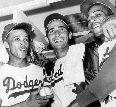 latimes:  Oct. 11, 1965: Dodgers, from left, Maury Wills, Sandy Koufax and Willie Davis celebrate after winning Game 5 of the 1965 World Series against the Minnesota Twins. In that game, Koufax pitched a four-hit shutout, striking out 10. View 130 photos for The Times' 130th birthday on Framework. Photo credit:	Lou Mack / Los Angeles Times