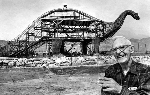 March 23, 1970: Sculptor Claude K. Bell with his 45-foot- tall, 150-foot-long brontosaur in Cabazon next to Interstate 10. Bell, a Knott's Berry Farm sculptor and portrait artist, opened the Wheel Inn cafe in 1958. To attract customers, he began building dinosaurs. View 130 photos for The Times' 130th birthday on Framework. Photo credit:	John Malmin / Los Angeles Times