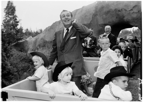 Film producer and entertainment mogul Walt Disney was born on this day in 1901. In this 1960 photo from our L.A. Examiner Collection, Disney accompanies his grandchildren on a train ride at Disneyland.