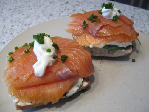 My lunch today: open faced smoked salmon sandwich.  This is my own little recipe, but I was inspired by one of my famous appetizers, which is smoked salmon and cream cheese on crostini. I adapted the appetizer to a sandwich size portions and have made this many times for family and friends for both brunch and lunch. The sandwich consists of smoked salmon (I used President's Choice) on top of a split multigrain ciabatta bun with a cream cheese mixture (chopped chives, lime juice, cream cheese and greek yogurt) and a dollop of greek yogurt and chives for garnish.