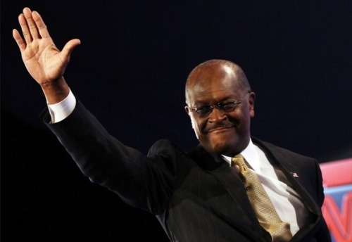 "Read our dance critic Sarah Kaufman on Herman Cain's body language: ""Cain surely has some of the most famous hands in the country. And that was true even before we heard allegations about them sliding unwanted under a woman's skirt."" Photo by Win McNamee (Getty)"