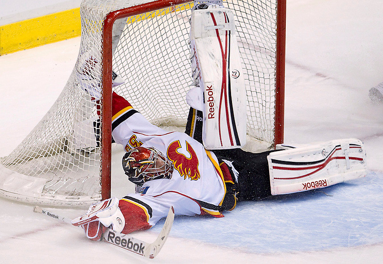 Calgary Flames goalie Henrik Karlsson stops Vancouver Canucks right wing Jannik Hansen's shot on net during first period NHL hockey action at Rogers Arena in Vancouver, British Columbia, Sunday, Dec, 4, 2011. (Photo by Jonathan Hayward) (via Sports Day In Pictures | Denver Post Media Center)
