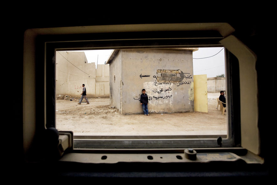 Via @CNN. A scene in Iraq captured through a Humvee window. Absolutely brilliant framing.